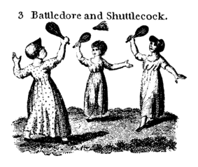 Three young girls play Battledore and Shuttlecock